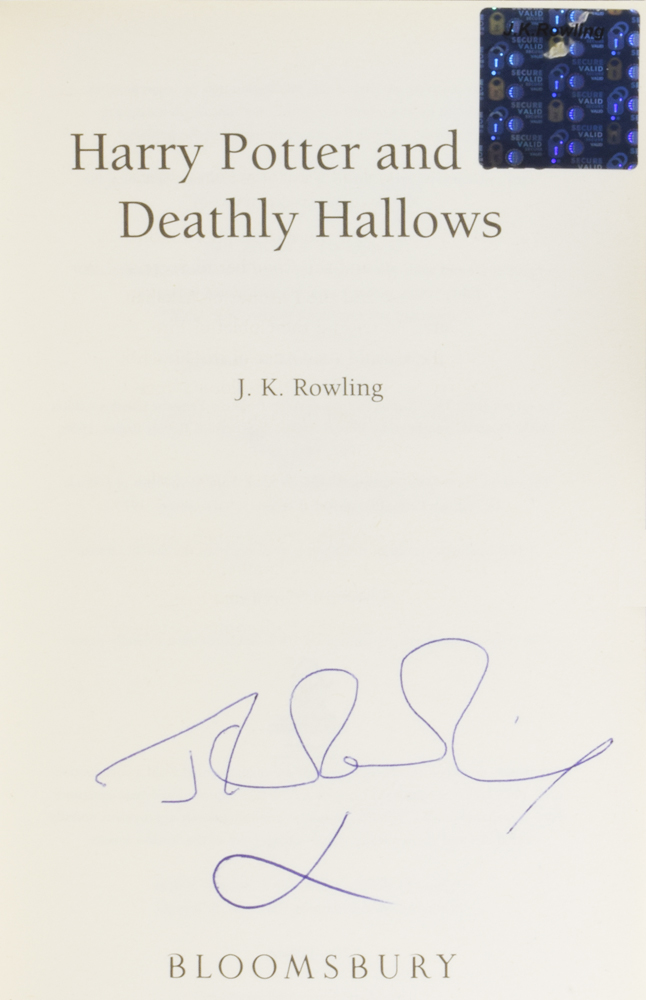 JK Rowling forgery with an authentic hologram inside of a Harry Potter and the deathly hallows being sold by Adrian Harrington