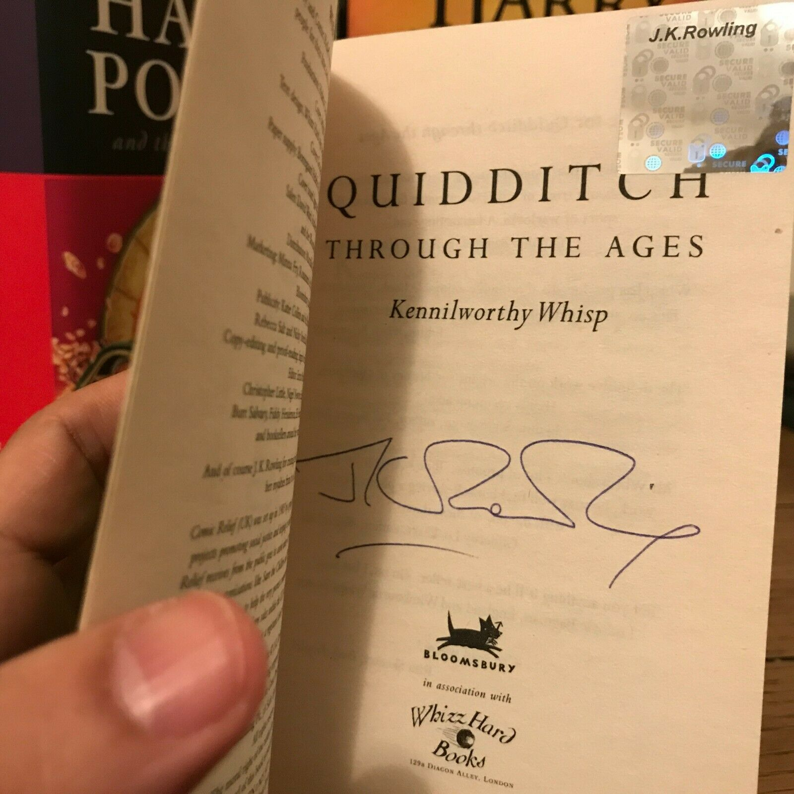 JK Rowling Forgery with an authentic hologram inside of a Quidditch Through the Ages