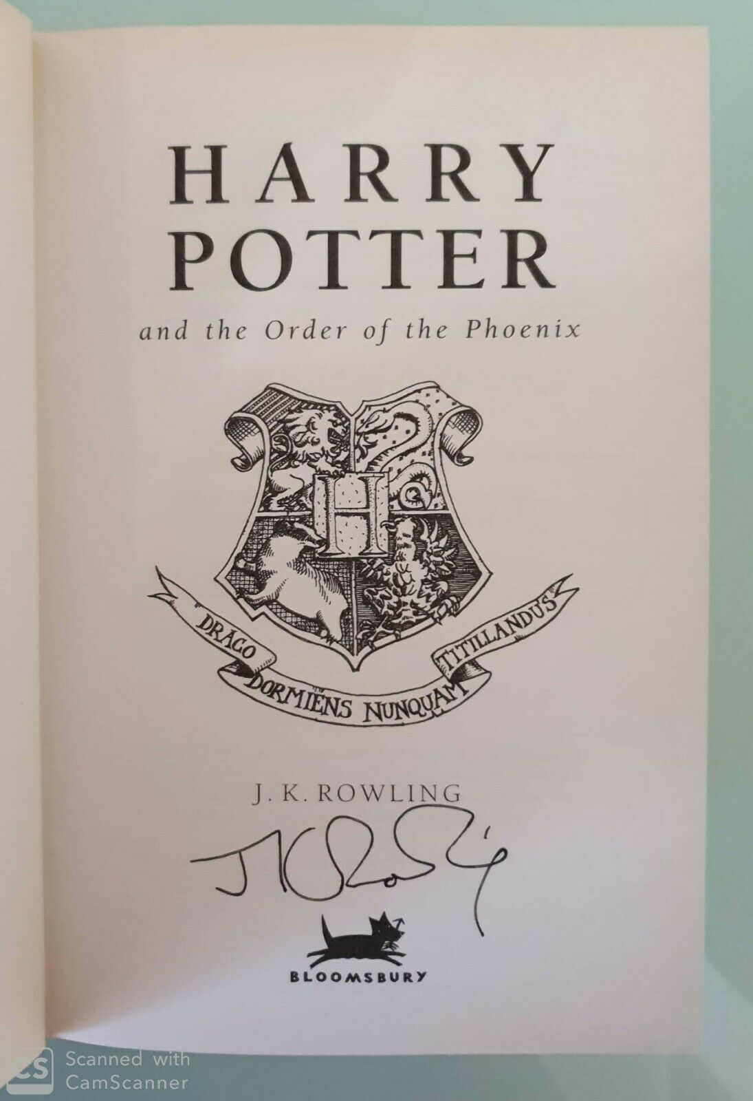J.K. Rowling Forgery signature found inside of a UK Bloomsbury Harry Potter and the Order of the Phoenix on eBay.
