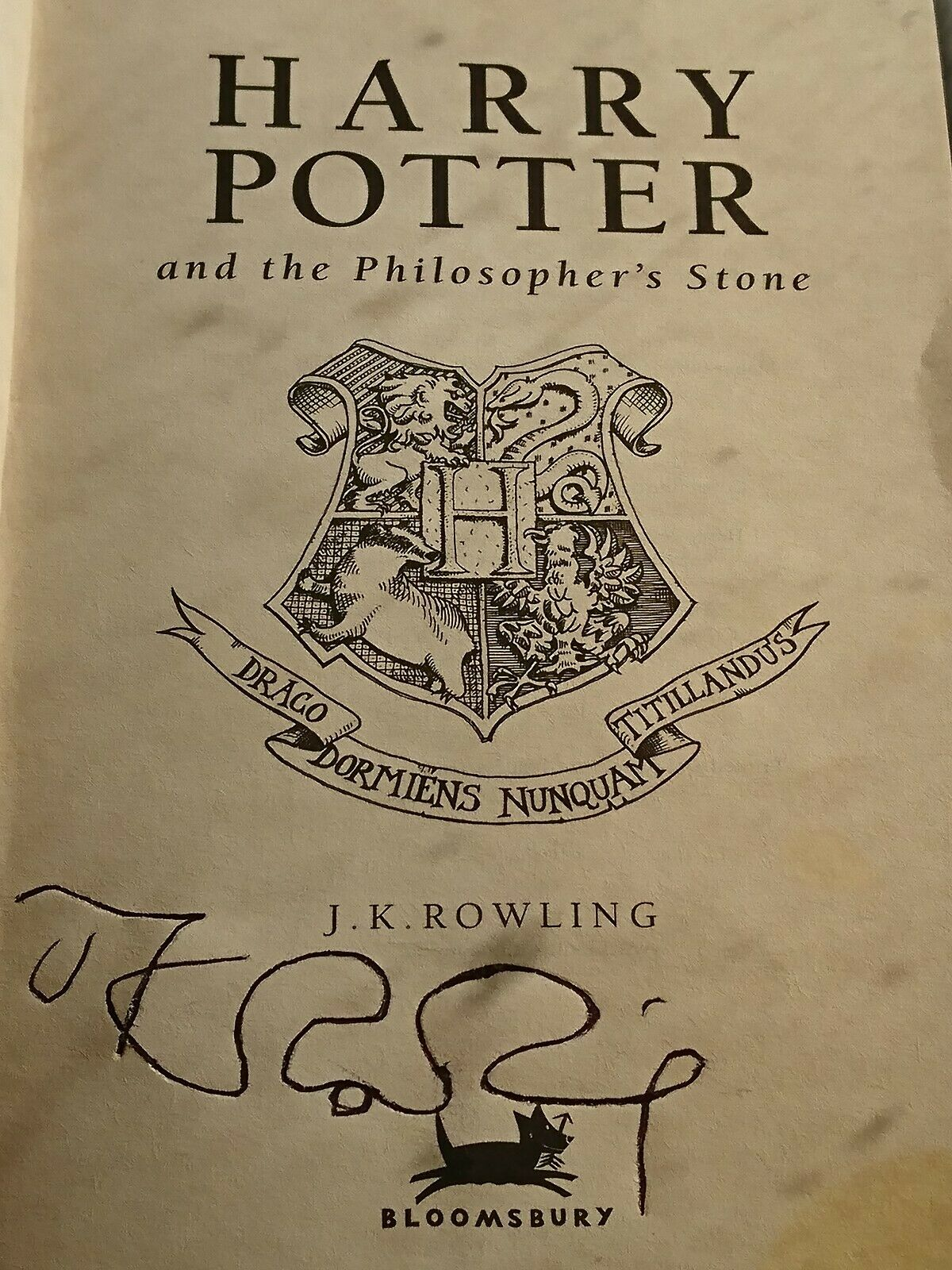 J.K. Rowling forgery found inside of a UK Celebration Edition of Harry Potter and the Philosopher's Stone on eBay.