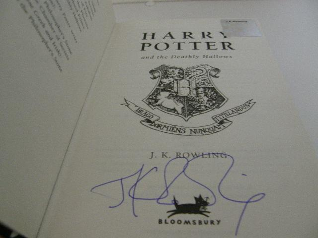 J.K. Rowling signature forgery found on Abebooks, listed for $4,000. Has what looks to be an authentic Rowling hologram, which was pulled from a lesser valued, authentically signed book. Sold by Quintessential Rare Books.
