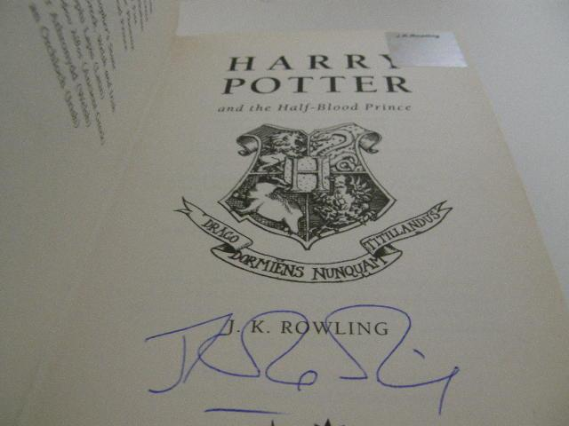 J.K. Rowling signature forgery found with an authentic J.K. Rowling hologram, which was more than likely pulled from a lesser valued, authentically signed book, like Casual Vacancy. Found on Abebooks. Sold by Quintessential Rare Books