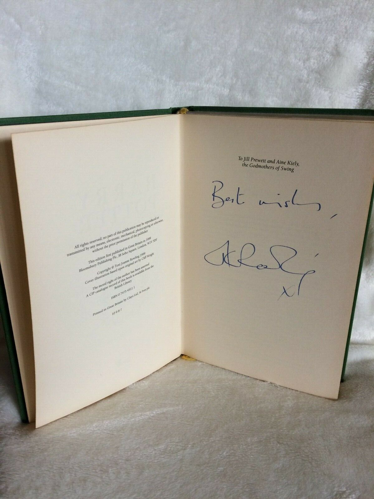 J.K. Rowling signature forgery found inside a Deluxe Edition Harry Potter and the Prisoner of Azkaban. Sold on eBay by MColes78.