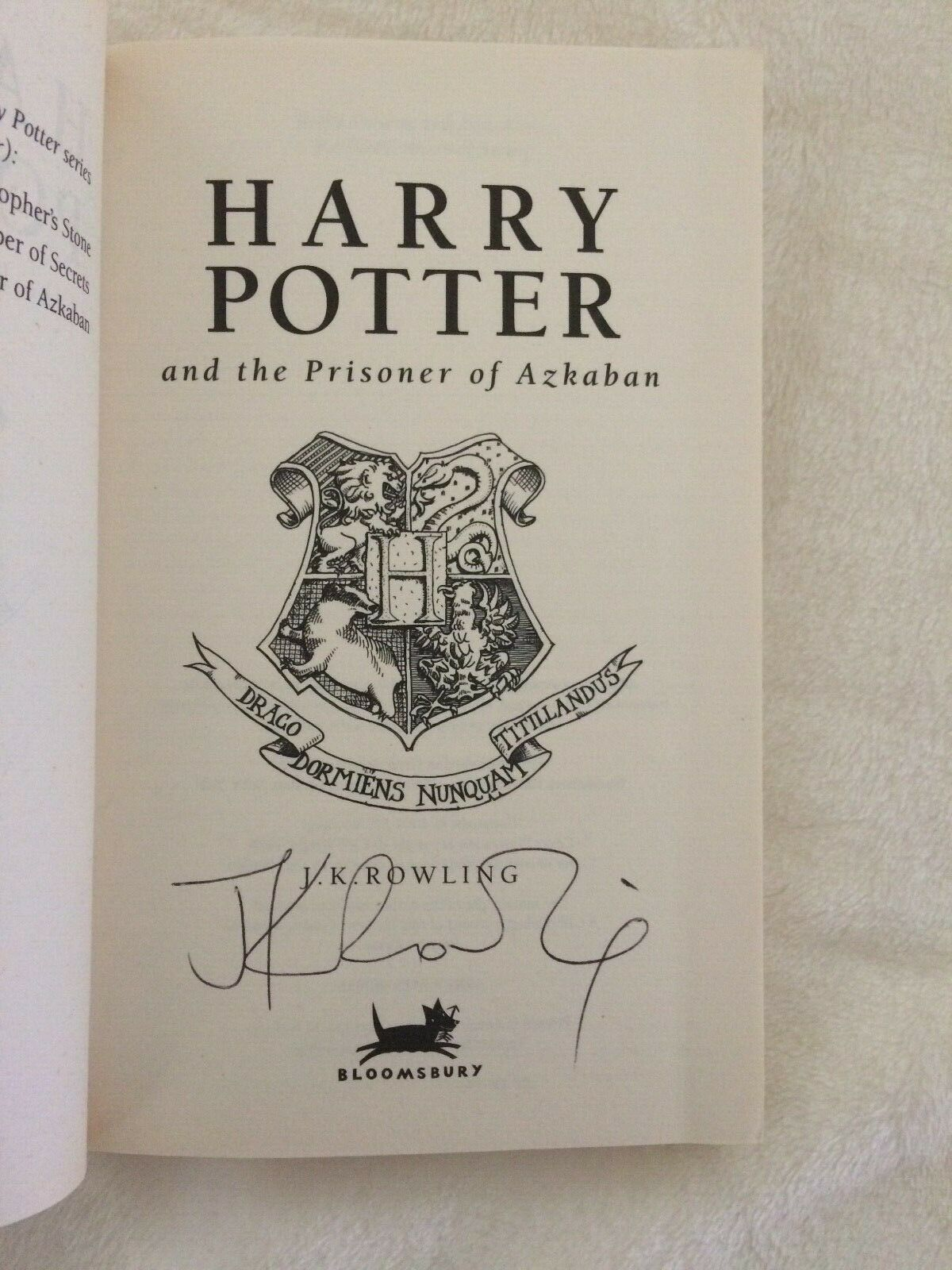 J. K. Rowling signature forgery found on ebay inside a UK Harry Potter and the Prisoner of Azkaban. Sold by Quartermain-75.