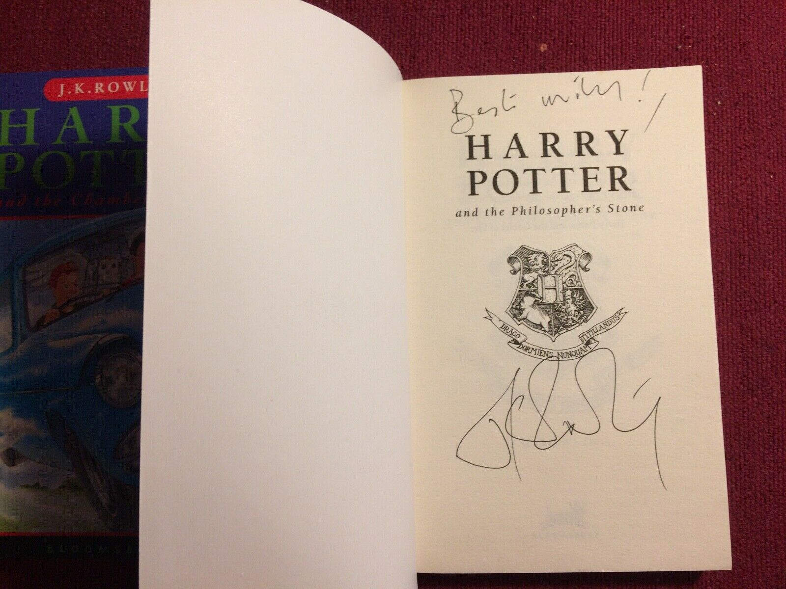 J.K. Rowling signature forgery found inside a Harry Potter and the Philosopher's Stone. Sold in a set with a forged Chamber of Secrets. Sold by MColes78 on eBay for 250 GBP.