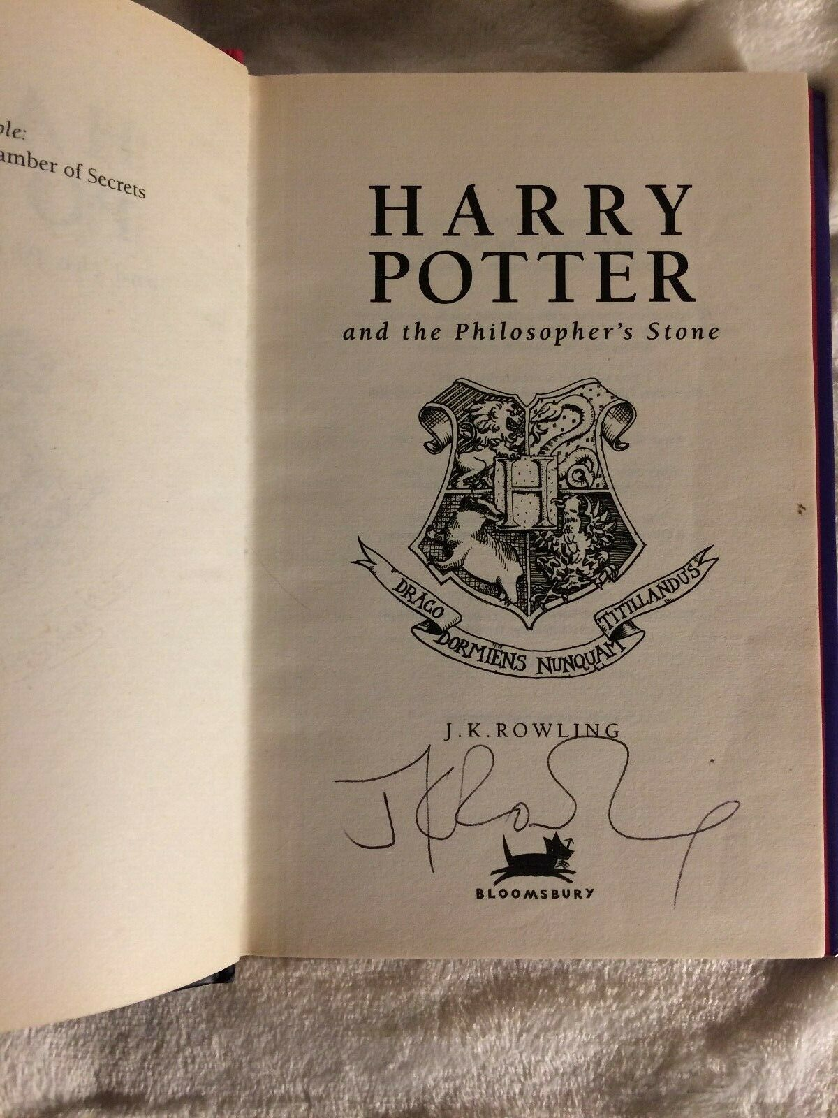 J.K. Rowling signature forgery found inside a Harry Potter and the Philosopher's Stone. SOld by MColes78 on eBay.